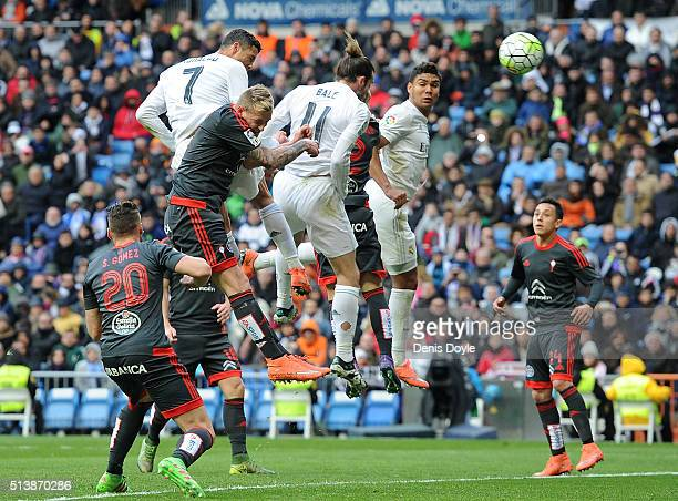 Cristiano Ronaldo of Real Madrid scores his 4th goal during the La Liga match between Real Madrid CF and Celta Vigo at Estadio Santiago Bernabeu on...