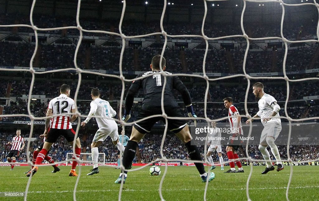 Cristiano Ronaldo of Real Madrid scores his equalising goal during the La Liga match between Real Madrid and Athletic Club at Estadio Santiago Bernabeu on April 18, 2018 in Madrid, Spain.