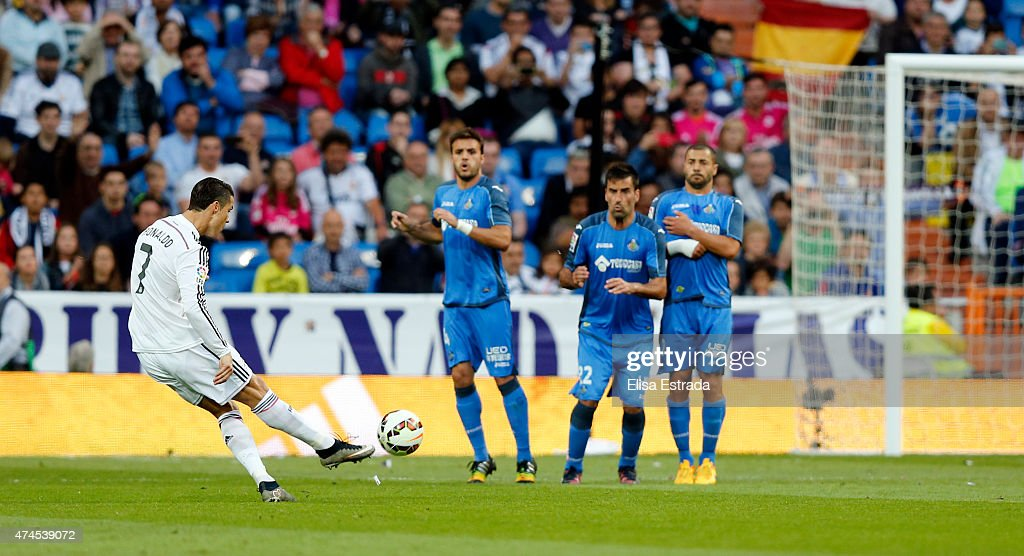 Cristiano Ronaldo of Real Madrid scores his second goal during the La Liga match between Real Madrid CF and Getafe CF at Estadio Santiago Bernabeu on May 23, 2015 in Madrid, Spain.
