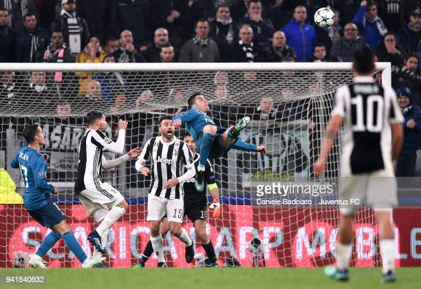 Cristiano Ronaldo of Real Madrid scores his second goal during the UEFA Champions League Quarter Final Leg One match between Juventus and Real Madrid...
