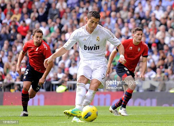 Cristiano Ronaldo of Real Madrid scores his second goal from the penalty spot during the La Liga match between Real Madrid and Osasuna at Estadio...