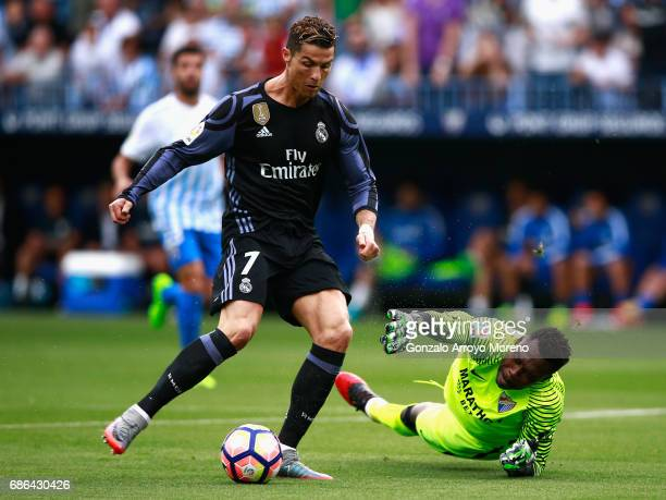 Cristiano Ronaldo of Real Madrid scores his sides first goal during the La Liga match between Malaga and Real Madrid at La Rosaleda Stadium on May 21...