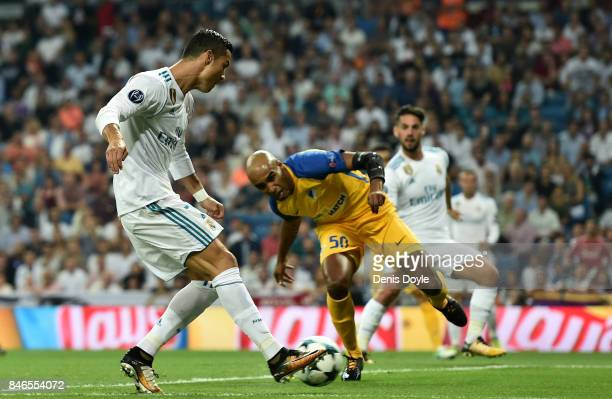 Cristiano Ronaldo of Real Madrid scores his sides first goal during the UEFA Champions League group H match between Real Madrid and APOEL Nikosia at...