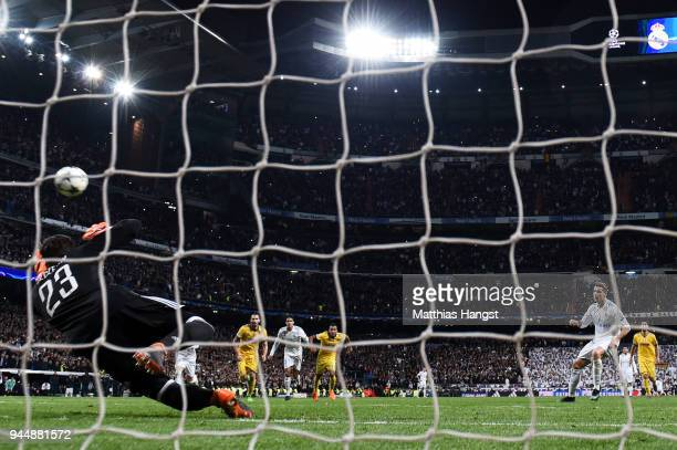 Cristiano Ronaldo of Real Madrid scores his sides first goal during the UEFA Champions League Quarter Final Second Leg match between Real Madrid and...