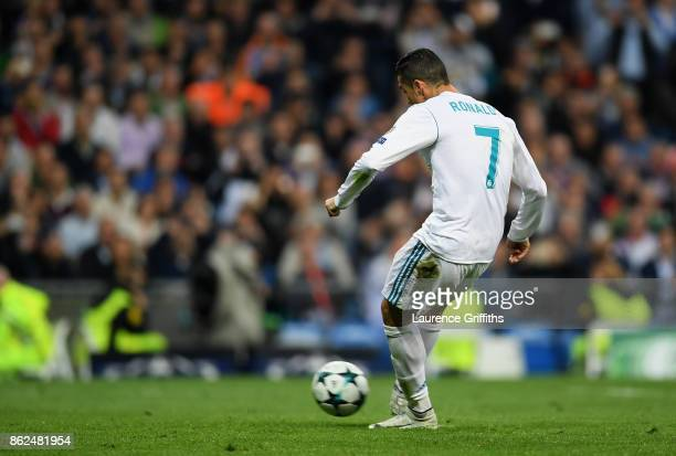 Cristiano Ronaldo of Real Madrid scores his sides first goal from the penalty spot during the UEFA Champions League group H match between Real Madrid...