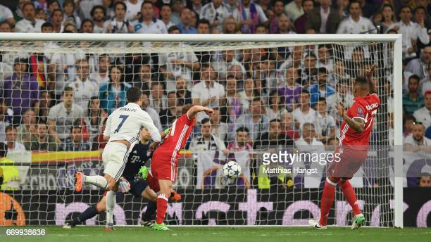 Cristiano Ronaldo of Real Madrid scores his sides first goal past Manuel Neuer of Bayern Muenchen during the UEFA Champions League Quarter Final...