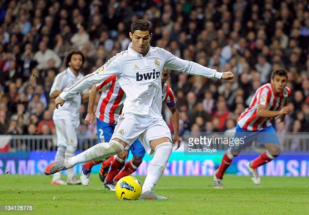 Cristiano Ronaldo of Real Madrid scores his sides opening goal from the penalty spot during the La Liga match between Real Madrid and Atletico Madrid...