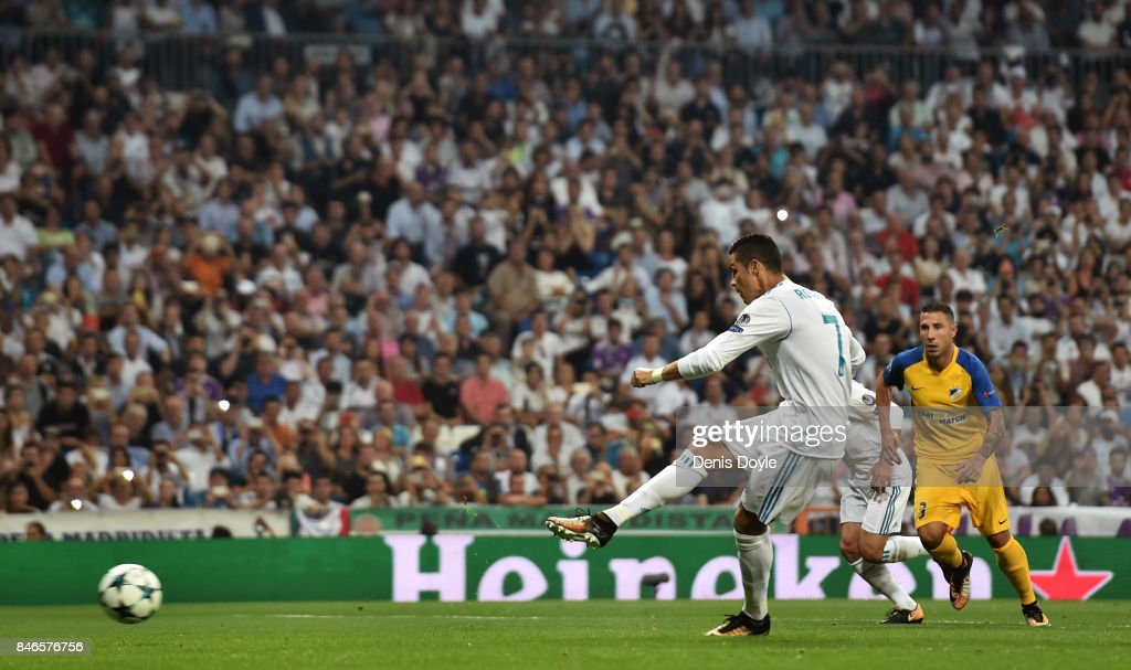 Cristiano Ronaldo of Real Madrid scores his sides second goal during the UEFA Champions League group H match between Real Madrid and APOEL Nikosia at Estadio Santiago Bernabeu on September 13, 2017 in Madrid, Spain.