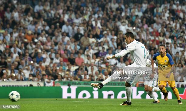 Cristiano Ronaldo of Real Madrid scores his sides second goal during the UEFA Champions League group H match between Real Madrid and APOEL Nikosia at...