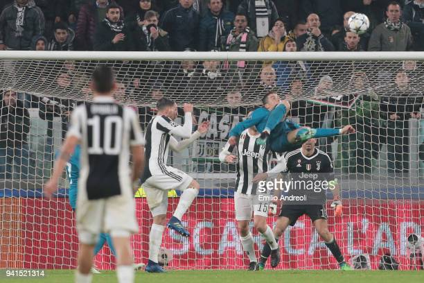 Cristiano Ronaldo of Real Madrid scores his sides second goal during the UEFA Champions League Quarter Final Leg One match between Juventus and Real...