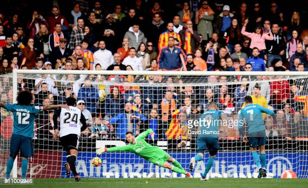 Cristiano Ronaldo of Real Madrid scores his side's second goal from the penalty spot during the La Liga match between Valencia and Real Madrid at...