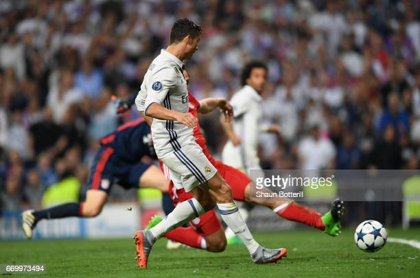 Cristiano Ronaldo of Real Madrid scores his sides third goal and his hatrick during the UEFA Champions League Quarter Final second leg match between...
