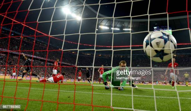 Cristiano Ronaldo of Real Madrid scores his team's 1st goal during the UEFA Champions League Quarter Final first leg match between FC Bayern Muenchen...