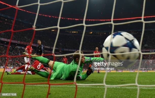 Cristiano Ronaldo of Real Madrid scores his team's first goal past goalkeeper Manuel Neuer of FC Bayern Muenchen during the UEFA Champions League...