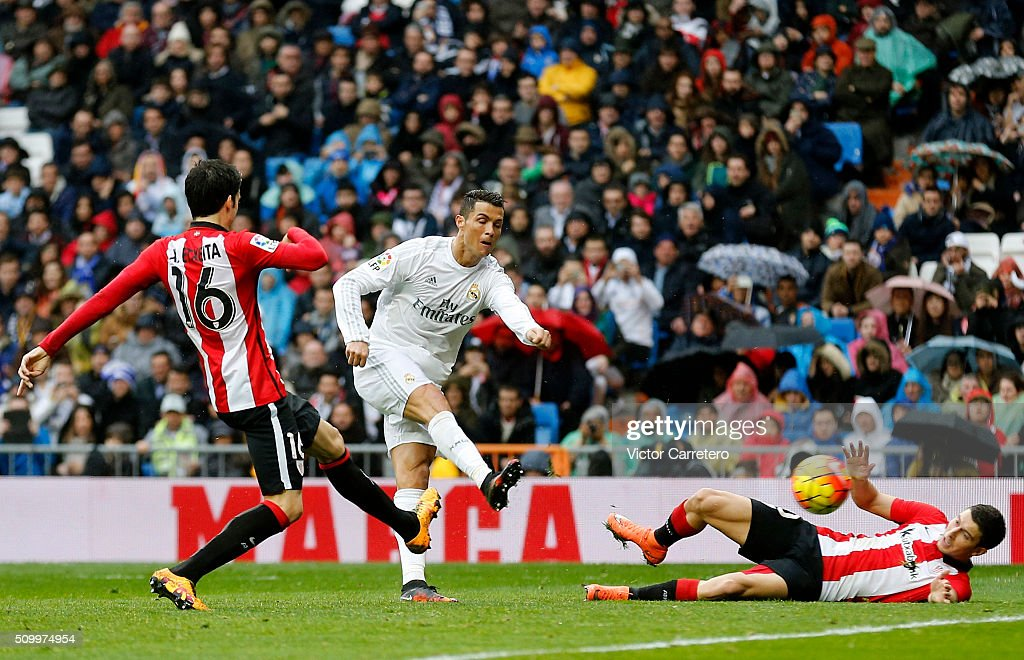 Cristiano Ronaldo of Real Madrid scores his team's fourth goal during the La Liga match between Real Madrid CF and Athletic Club at Estadio Santiago Bernabeu on February 13, 2016 in Madrid, Spain.