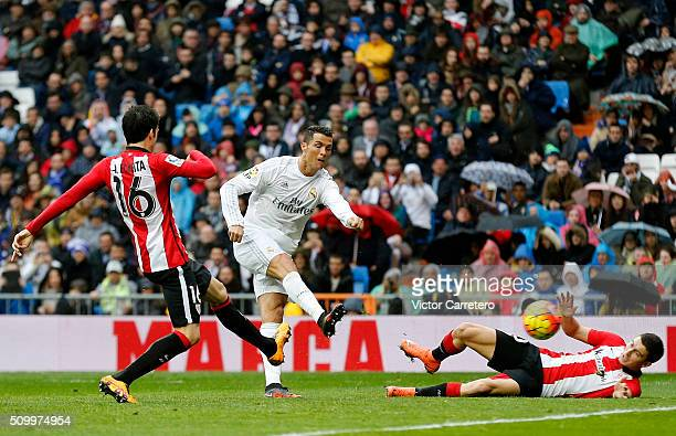 Cristiano Ronaldo of Real Madrid scores his team's fourth goal during the La Liga match between Real Madrid CF and Athletic Club at Estadio Santiago...