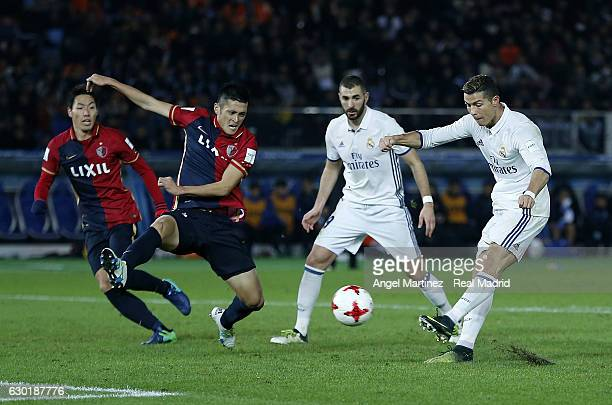 Cristiano Ronaldo of Real Madrid scores his team's fourth goal during the FIFA Club World Cup Final match between Real Madrid and Kashima Antlers at...