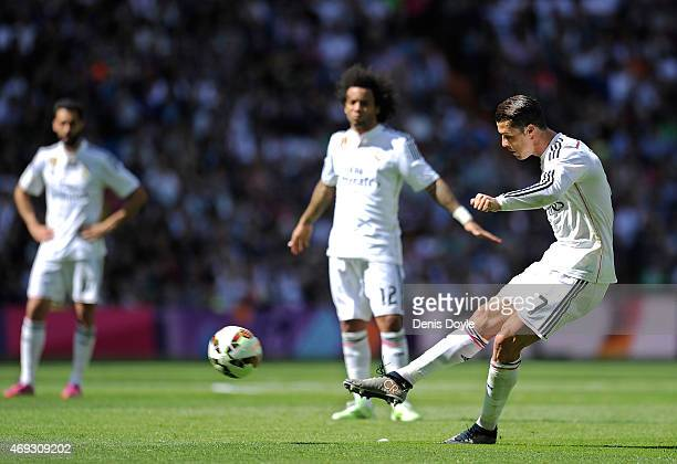 Cristiano Ronaldo of Real Madrid scores his team's opening goal from a free kick during the La Liga match between Real Madrid and Eibar at Estadio...