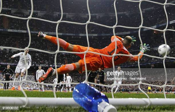 Cristiano Ronaldo of Real Madrid scores his team's opening goal from the penalty spot during the UEFA Champions League Round of 16 First Leg match...