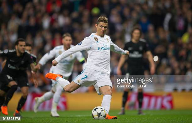 Cristiano Ronaldo of Real Madrid scores his teamÕs opening goal from the penalty spot during the UEFA Champions League Round of 16 First Leg match...