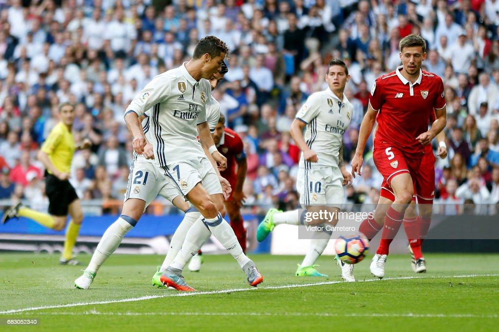 Cristiano Ronaldo of Real Madrid scores his team's second goal during the La Liga match between Real Madrid and Sevilla FC at Estadio Santiago Bernabeu on May 14, 2017 in Madrid, Spain.
