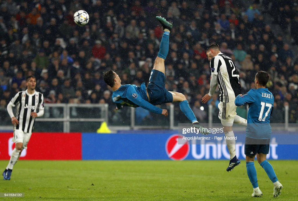 Cristiano Ronaldo of Real Madrid scores his team's second goal during the UEFA Champions League Quarter Final Leg One match between Juventus and Real Madrid at Juventus Stadium on April 3, 2018 in Turin, Italy.