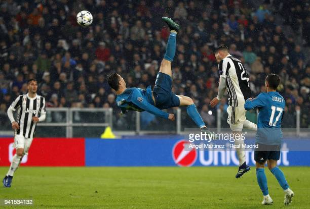 Cristiano Ronaldo of Real Madrid scores his team's second goal during the UEFA Champions League Quarter Final Leg One match between Juventus and Real...
