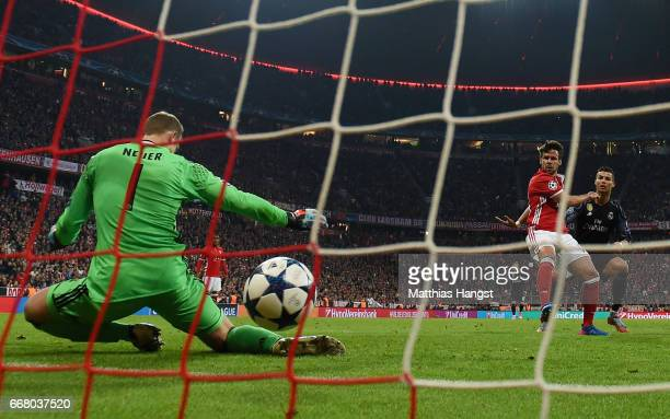 Cristiano Ronaldo of Real Madrid scores his team's second goal past goalkeeper Manuel Neuer of FC Bayern Muenchen during the UEFA Champions League...
