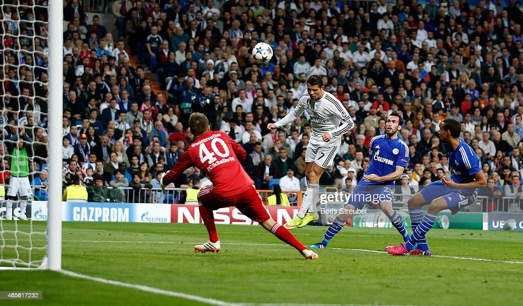 Cristiano Ronaldo (2.L) of Real Madrid scores his team's second goal with a header during the UEFA Champions League Round of 16 second leg match between Real Madrid CF and FC Schalke 04 at Estadio Santiago Bernabeu on March 10, 2015 in Madrid, Spain.