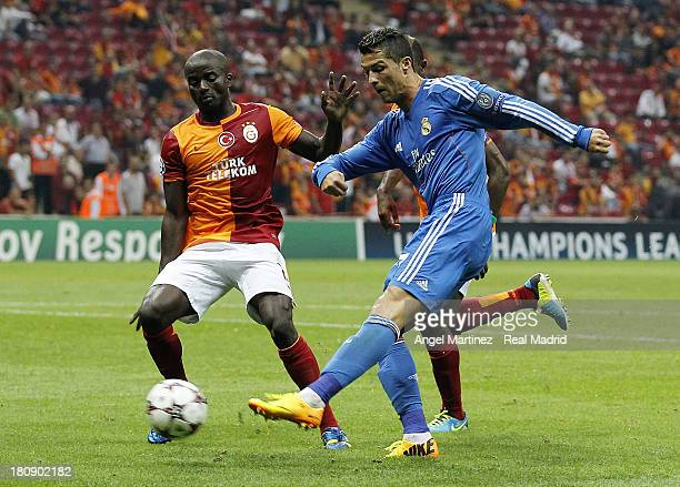 Cristiano Ronaldo of Real Madrid scores his team's sixth goal past Dany Nounkeu of Galatasaray AS during the UEFA Champions League group B match...