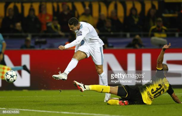 Cristiano Ronaldo of Real Madrid scores his team's third goal during the UEFA Champions League group H match between Borussia Dortmund and Real...