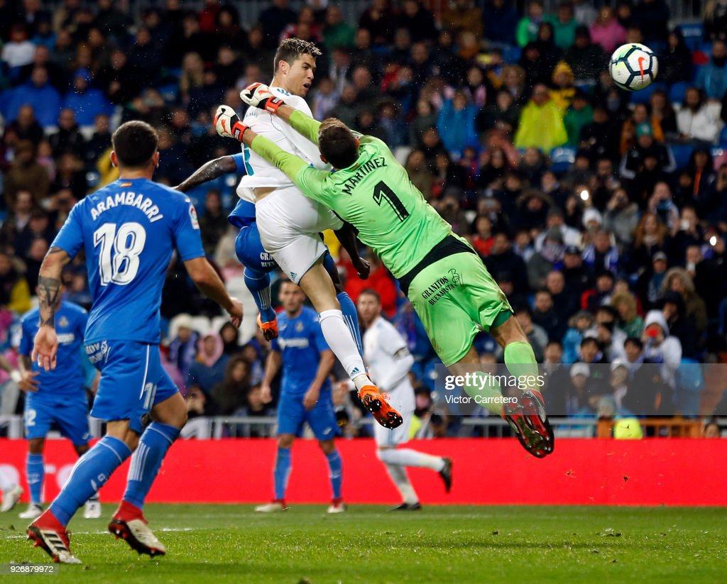 Cristiano Ronaldo of Real Madrid scores his team's third goal during the La Liga match between Real Madrid and Getafe at Estadio Santiago Bernabeu on March 3, 2018 in Madrid, Spain.