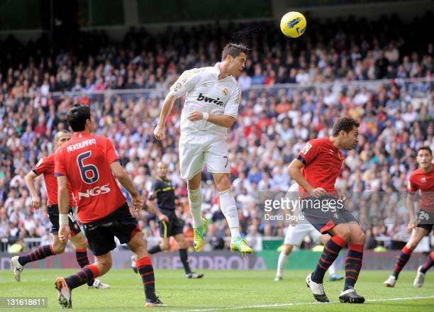 Cristiano Ronaldo of Real Madrid scores his third goal during the La Liga match between Real Madrid and Osasuna at Estadio Santiago Bernabeu on...