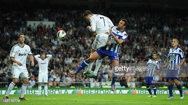 Cristiano Ronaldo of Real Madrid scores past Carlos Marchena of Deportivo La Coruna during the la Liga match between Real Madrid CF and RC Deportivo...