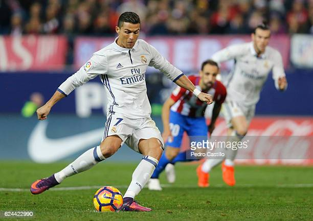 Cristiano Ronaldo of Real Madrid scores Real's 2nd goal during the La Liga match between Club Atletico de Madrid and Real Madrid CF at Vicente...