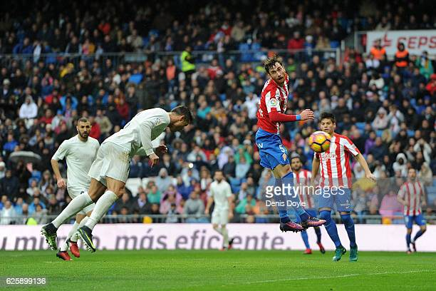 Cristiano Ronaldo of Real Madrid scores Real's 2nd goal from during the La Liga match between Real Madrid CF and Real Sporting de Gijon at Estadio...