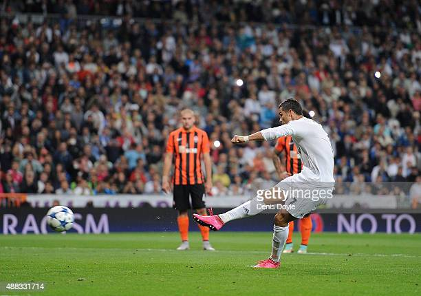 Cristiano Ronaldo of Real Madrid scores Real's 2nd goal from the penalty spot during the UEFA Champions League Group A match between Real Madrid and...