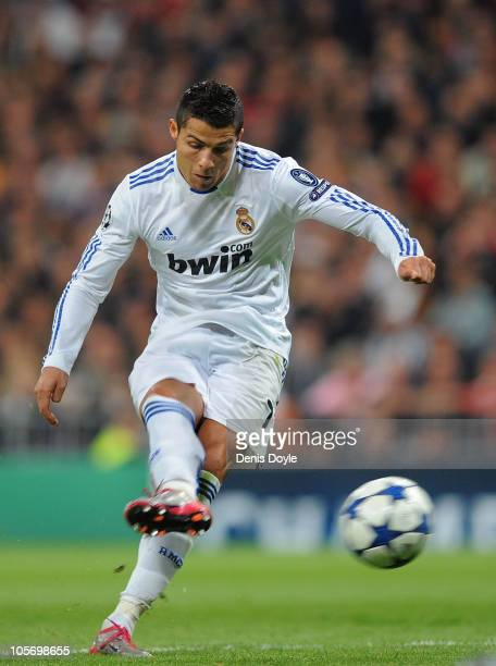 Cristiano Ronaldo of Real Madrid scores Real's first goa from a free kickl during the UEFA Champions League Group G match between Real Madrid and AC...