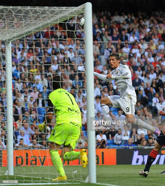 Cristiano Ronaldo of Real Madrid scores Real's third goal during the La Liga match between Real Madrid and CA Osasuna at Estadio Santiago Bernabeu on...