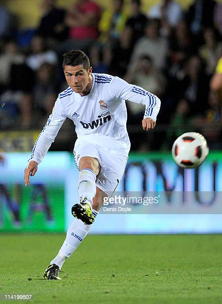 Cristiano Ronaldo of Real Madrid scores Real's third goal from a free kick during the La Liga match between Villarreal and Real Madrid at estadio El...