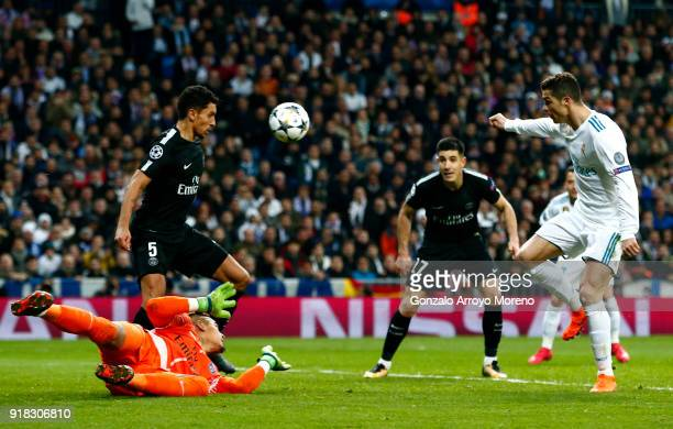 Cristiano Ronaldo of Real Madrid scores the 2nd Real Madrid goal during the UEFA Champions League Round of 16 First Leg match between Real Madrid and...