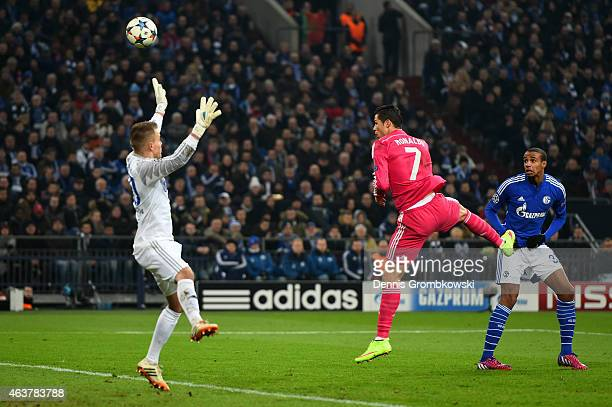 Cristiano Ronaldo of Real Madrid scores the opening goal by heading the ball over goalkeeper Timon Wellenreuther of Schalke during the UEFA Champions...