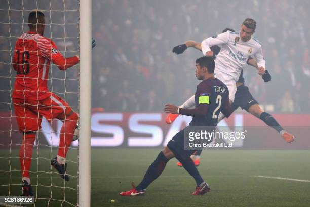 Cristiano Ronaldo of Real Madrid scores the opening goal during the UEFA Champions League Round of 16 Second Leg match between Paris SaintGermain and...