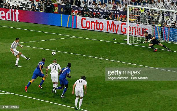 Cristiano Ronaldo of Real Madrid scores the opening goal from the penalty spot past Gianluigi Buffon of Juventus during the UEFA Champions League...
