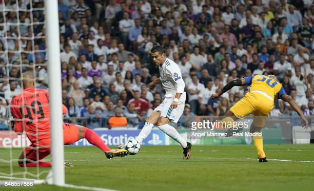 Cristiano Ronaldo of Real Madrid scores the opening goal past Boy Waterman of APOEL Nikosia during the UEFA Champions League group H match between...