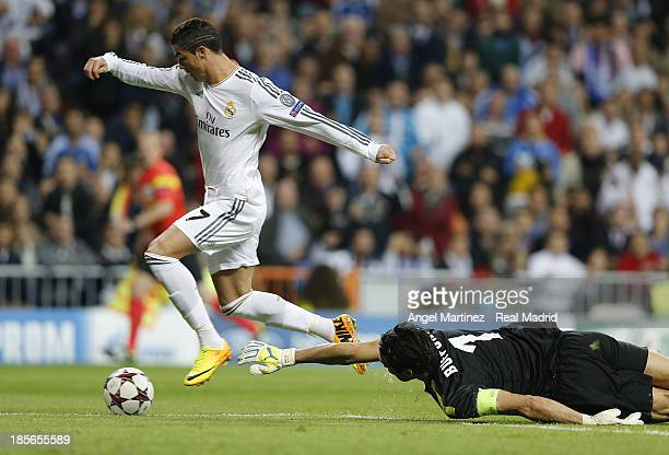 Cristiano Ronaldo of Real Madrid scores the opening goal past Gianluigi Buffon of Juventus during the UEFA Champions League Group B match between...