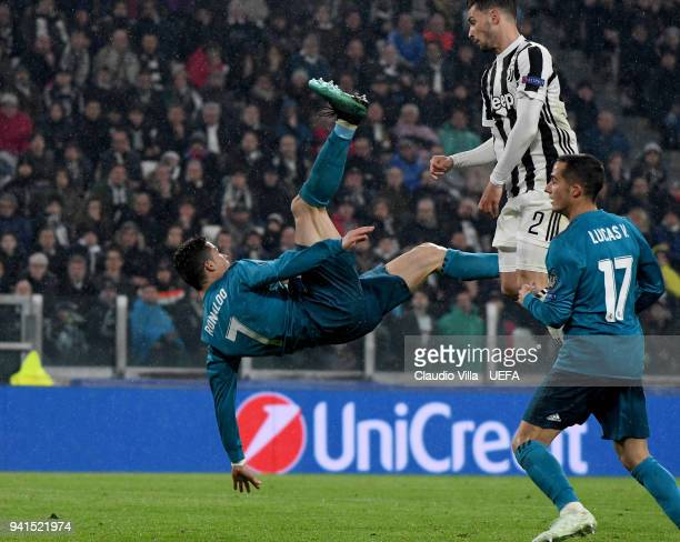 Cristiano Ronaldo of Real Madrid scores the second goal during the UEFA Champions Quarter Final Leg One match between Juventus and Real Madrid at...