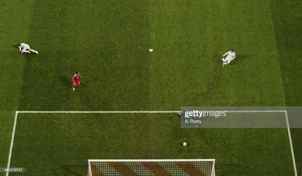 Cristiano Ronaldo of Real Madrid scores the third goal during the UEFA Champions League semi-final second leg match between FC Bayern Muenchen and Real Madrid at Allianz Arena on April 29, 2014 in Munich, Germany.