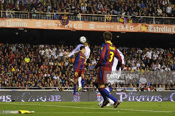 Cristiano Ronaldo of Real Madrid scores the winning goal during the Copa del Rey Final between Real Madrid and Barcelona at Estadio Mestalla on April...