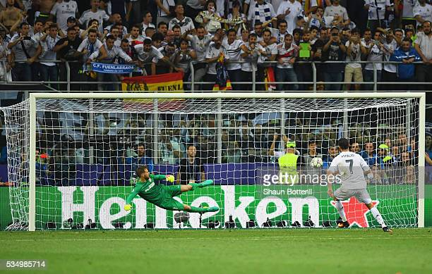 Cristiano Ronaldo of Real Madrid scores the winning penalty during the UEFA Champions League Final match between Real Madrid and Club Atletico de...